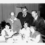 """Advisory Board members Knights Thomas P. Alfano, Albert W. Susie, and Clay J. Bossart with students of Saint Anthony Schools at an """"envelope stuffing party"""" - 1976 (Obtained/provided by the Diocese of Pittsburgh Archives & Records Center)"""