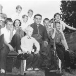 Bishop John J. Wright with twelve children on hay ride at St Anthony's School, Oakmont – undated (Obtained/provided by the Diocese of Pittsburgh Archives & Records Center)